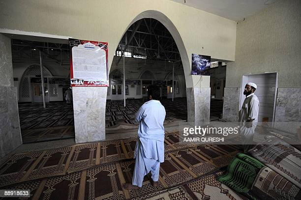 In this photograph taken on July 8 a Pakistani Muslim reads the will of late Red Mosque deputy chief Abdul Rashid Ghazi the younger brother of chief...