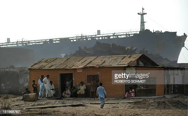 In this photograph taken on July 9 shipyard workers come together to relax at the end of a day's work in a modest house at one of the 127...
