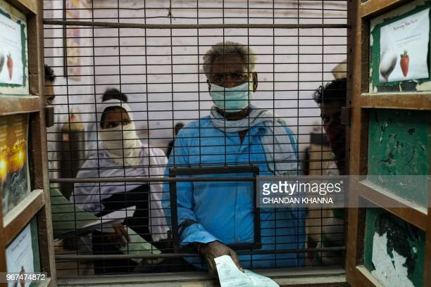 In this photograph taken on June 1 Indian patients suffering from breathing problems and tuberculosis are admitted for treatment at the Murari Lal...