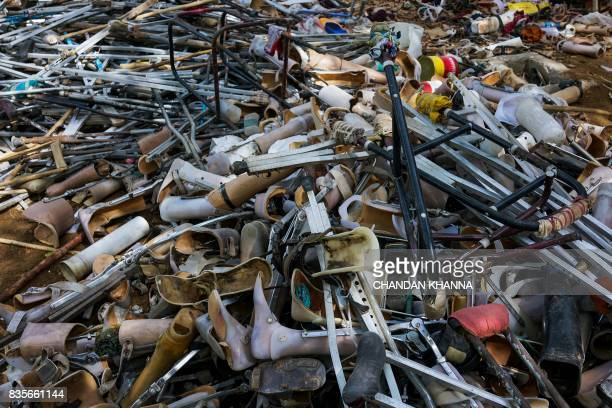 In this photograph taken on June 13 old prosthetic legs feet and crutches are seen in a big pile at the Bhagwan Mahaveer Viklang Sahayata Samiti...