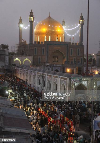 In this photograph taken on June 18 Pakistani devotees gather at the shrine of 13th century Muslim Sufi saint Lal Shahbaz Qalandar in Sehwan some 200...