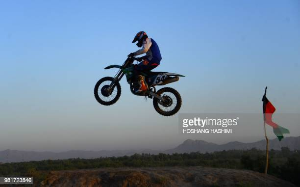 In this photograph taken on June 22 2018 an Afghan rider takes part in a freestyle motocross event in the western city of Herat