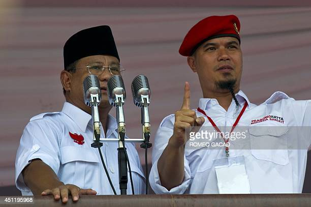 In this photograph taken on June 22 Indonesian presidential candidate Prabowo Subianto appears together with rock star Ahmad Dhani after the latter...