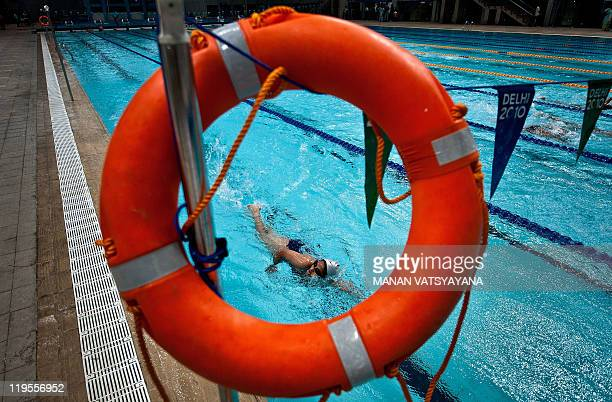 In this photograph taken on June 27 an Indian swimmer trains at The Shayama Prasad Mukherjee Swimming complex, the main swimming events venue for the...