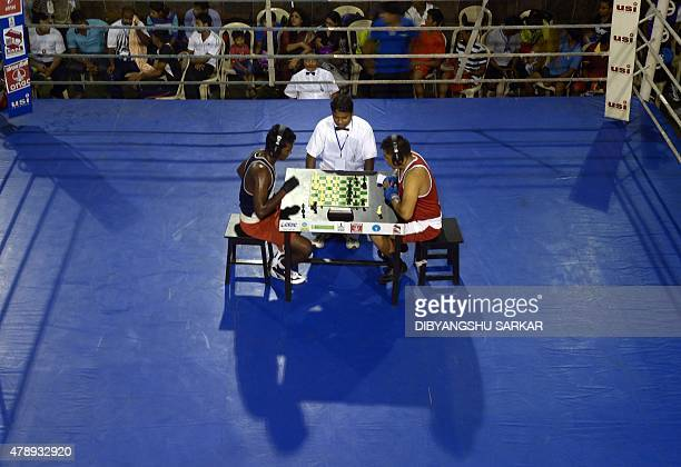 In this photograph taken on June 28 Indian chessboxers play a round of chess during the boxing round of The National Chess Boxing Championships in...
