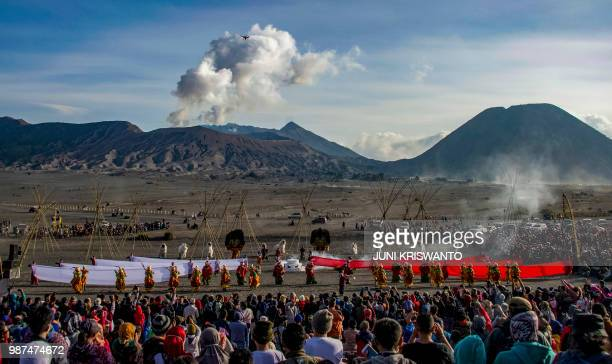 TOPSHOT In this photograph taken on June 29 2018 dancers perform during the Bromo cultural event near Mount Bromo in Probolinggo in East Java as part...