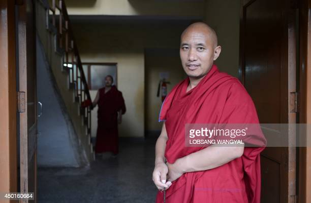 In this photograph taken on June 4 Tibetan monk Sonam Rapgha poses in Dharamsala Tibetan monk Sonam Rapgha who managed to cross the border into India...