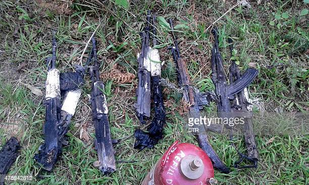 In this photograph taken on June 4 weapons of the Indian army personel who were killed by militants lie at the scene of an attack on a military...