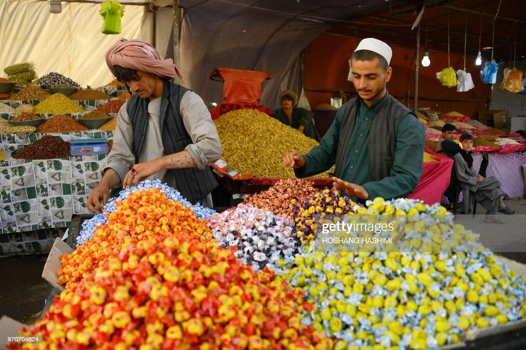 In this photograph taken on June 9, 2018 an Afghan dry fruits and