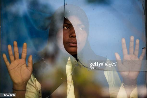 In this photograph taken on March 2 an ethnic Rohingya refugee who was among two boatloads of asylumseekers carrying 184 people from Myanmar rescued...