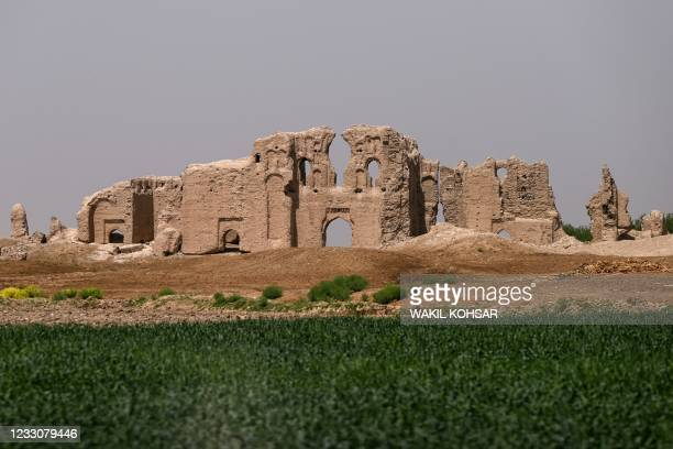In this photograph taken on March 27 the ruins of a palace is pictured near the historic fortress of Qala-e-Bost, in Bost on the outskirts of Lashkar...
