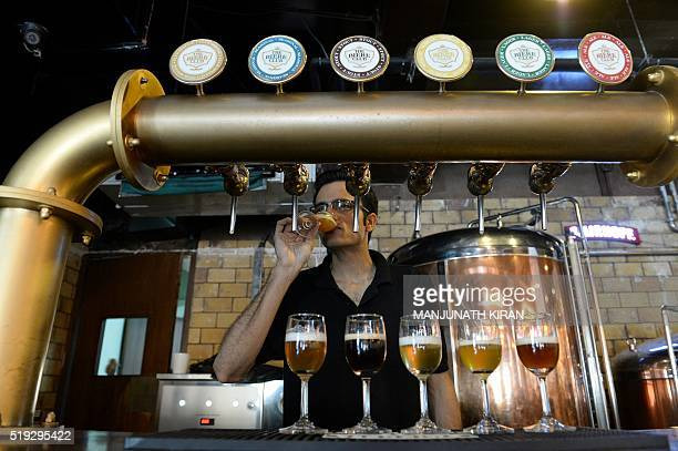 In this photograph taken on March 31 Head Brewer at The Biere Club Rohit Jairam Parwani tastes craft beer at the microbrewery in Bangalore India's...