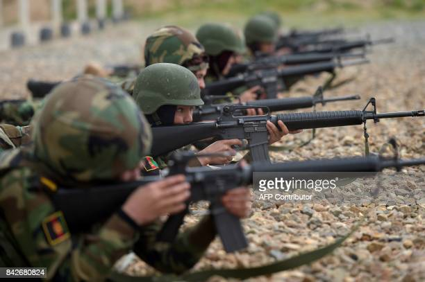 In this photograph taken on May 1 Afghan National Army female soldiers shoot their rifles during a live firing exercise at the Kabul Military...