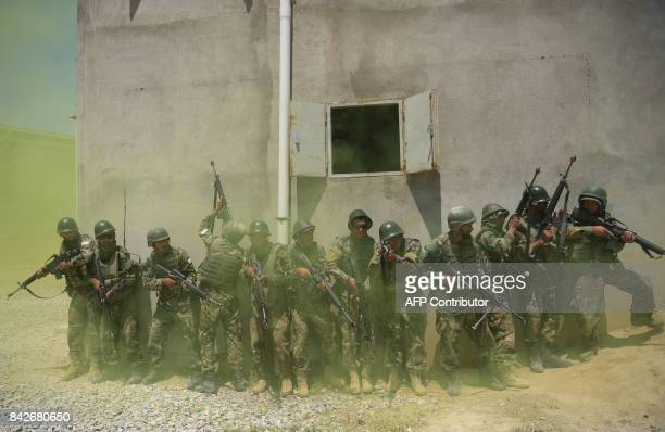 In this photograph taken on May 1 Afghan National Army soldiers train at the Kabul Military training centre on the outskirts of Kabul. Fresh recruits...
