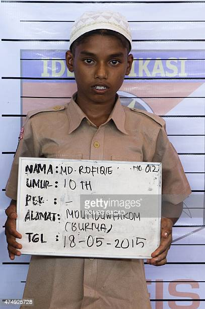 In this photograph taken on May 18 Muhammad Rofiqie a 10year old Rohingya boy from Myanmar poses as he undergoes identification procedures by...