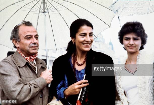 In this photograph taken on May, 1977 Greek-cypriot film director Michael Cacoyannis poses with Greek actresses Irene Papas and Tatiana Papamoschou...