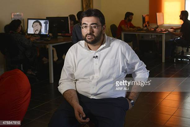 In this photograph taken on May 20 Pakistani comic book creator and cofounder and CEO of Creative Frontiers Mustafa HasnainNadir speaks during an...