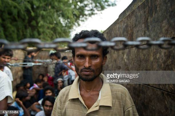 In this photograph taken on May 20 Rohingya men from Myanmar are transported on a truck in Langsa Aceh province after they were rescued by Indonesian...