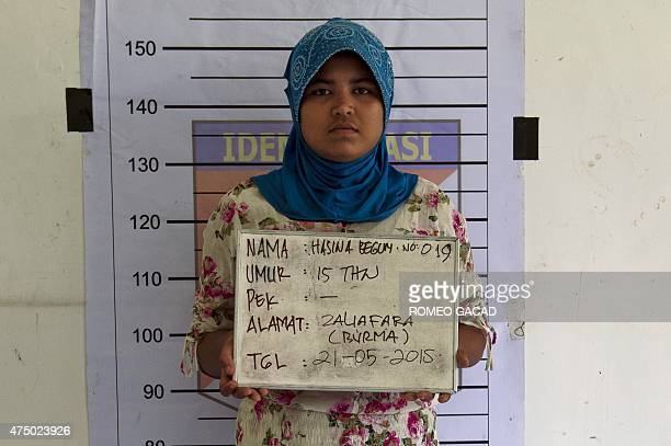 In this photograph taken on May 21 Hasina Begum a 19 year old Rohingya woman from Myanmar poses as she undergoes identification procedure by...