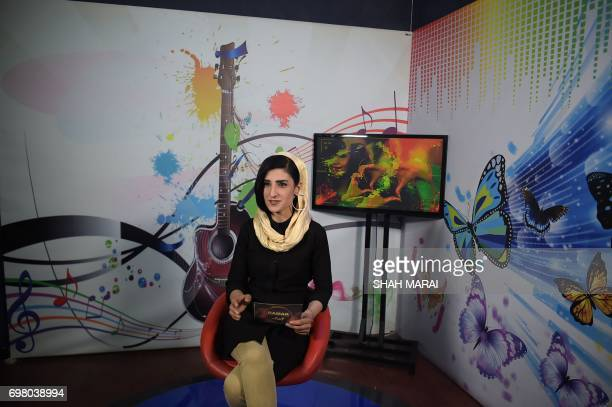 In this photograph taken on May 24 Krishma Naz presenter of a music show takes part in a recording at the Zan TV station in Kabul Afghan women are...