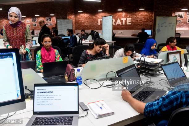 In this photograph taken on May 24 Pakistani youngsters work at their desks at the National Incubation Centre one of Pakistans largest startup...