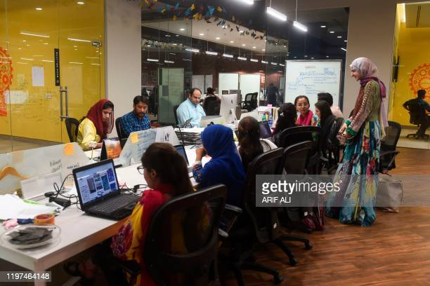In this photograph taken on May 24 People work at their stations at the National Incubation Centre a startup incubator in Lahore Pakistan's...