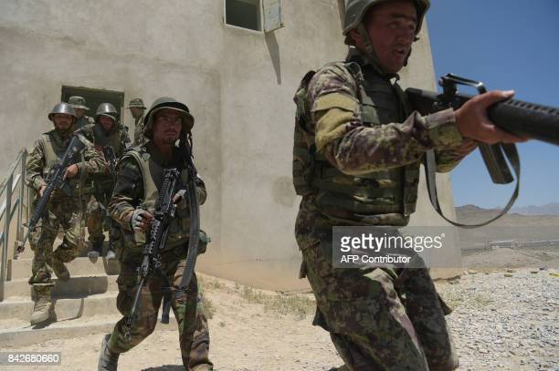 In this photograph taken on May 3 Afghan National Army soldiers train at the Kabul Military training centre on the outskirts of Kabul. Fresh recruits...