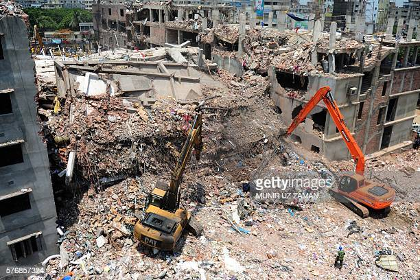 In this photograph taken on May 3 Bangladeshi rescuers use diggers to move debris as Bangladeshi Army personel continue the second phase after the...