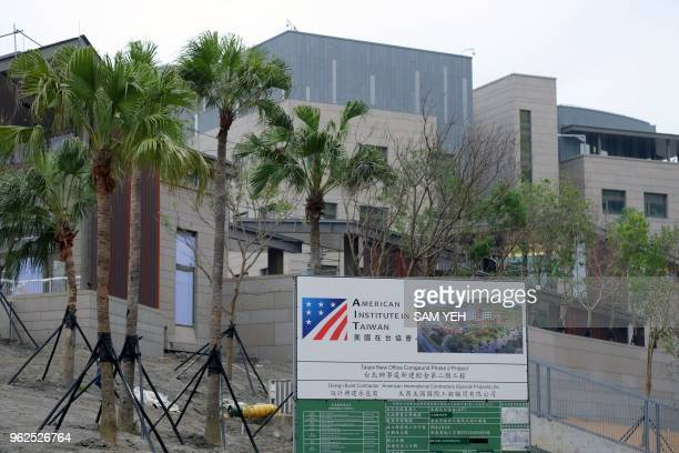 In this photograph taken on May 3 construction signage is seen in front of the newlybuilt American Institute in Taipei building in Taipei Diplomacy...