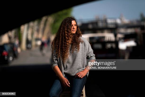 In this photograph taken on May 4 French round the world sailor Marie Tabarly poses during a photo session on the banks of the River Seine in Paris