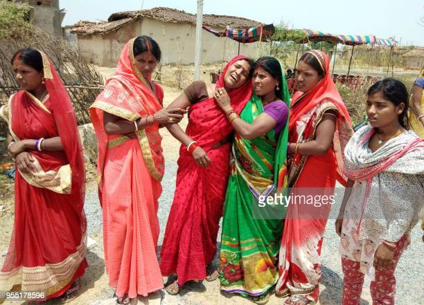 TOPSHOT In this photograph taken on May 5 Indian relatives mourn following the rape and murder of a 16yearold girl on May 3 at Raja Kundra Village in...