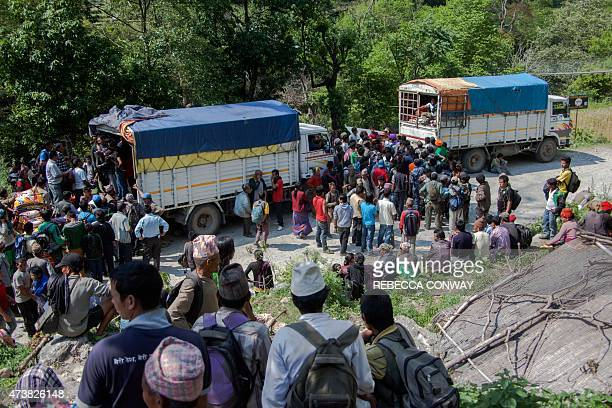 In this photograph taken on May 5 Nepalese earthquake survivors wait for food aid and other supplies distributed by Nepali NGO the Earthquake Relief...