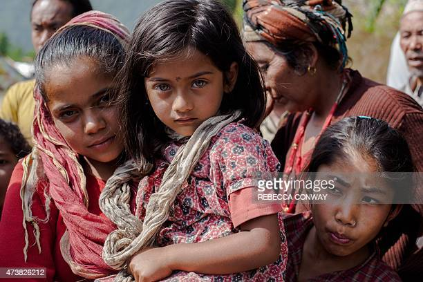 In this photograph taken on May 5 Nepalese residents displaced by an earthquake gather to wait for aid distributed by the Nepal Army and NGO groups...
