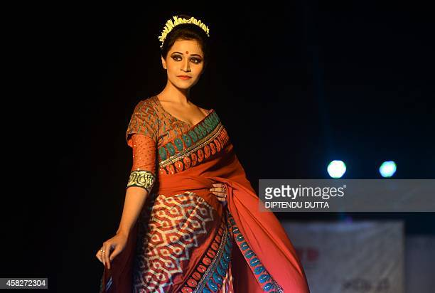In this photograph taken on November 1 2014 an Indian model displays a creation by designer Agnimitra Paul during a fashion event entitled 'Fall...