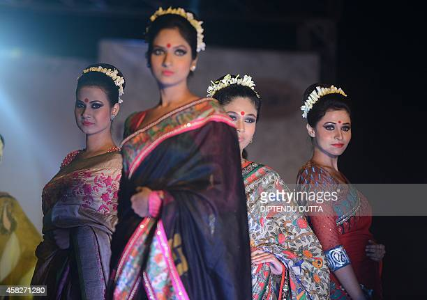 In this photograph taken on November 1 2014 Indian models display creations by designer Agnimitra Paul during a fashion event entitled 'Fall Winter...