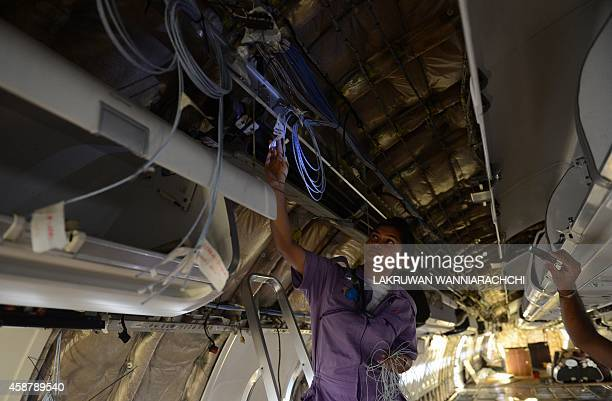 In this photograph taken on November 10 2014 SriLankan Airlines women technical staff carry out a refit of an Airbus A330 at the main international...