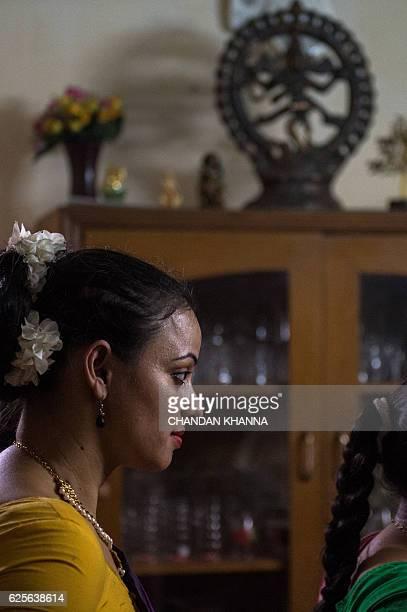 In this photograph taken on November 11 a dance student watches her guru Aayurshi Neeraj during a dress rehearsal performance of the Bharatnatyam...