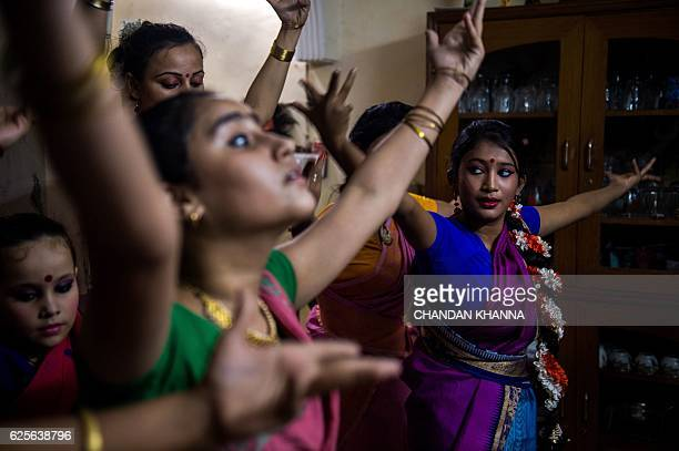 In this photograph taken on November 11 dance students perform during a dress rehearsal performance of the Bharatnatyam dance under the tutelage of...