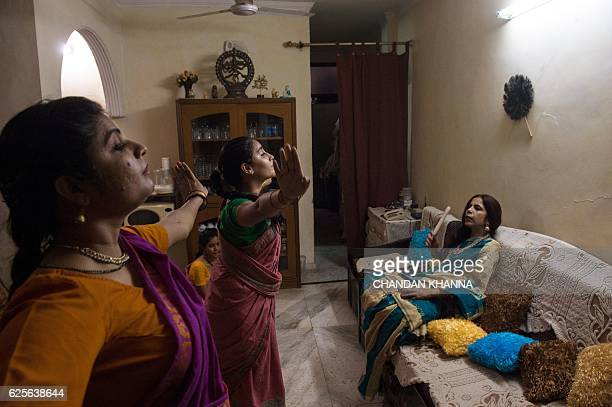 In this photograph taken on November 11 students perform during a dress reharsal performance of the Bharatnatyam dance as they learn from their guru...