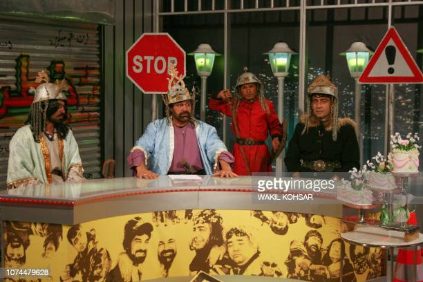 In this photograph taken on November 15 Afghan comedian Hanif Hamgam , Sayed Nabi Fakhri , Qaseem Ibrahimi and Nasrat Haidari perform a scene for the...