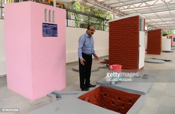 In this photograph taken on November 15 Sulabh International Museum of Toilets scientist RC Jha displays a toilet that can incinerate waste in New...