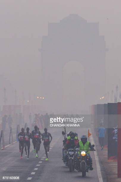 In this photograph taken on November 20 participants make their way along Rajpath during the Delhi Half Marathon in New Delhi A court in India's...