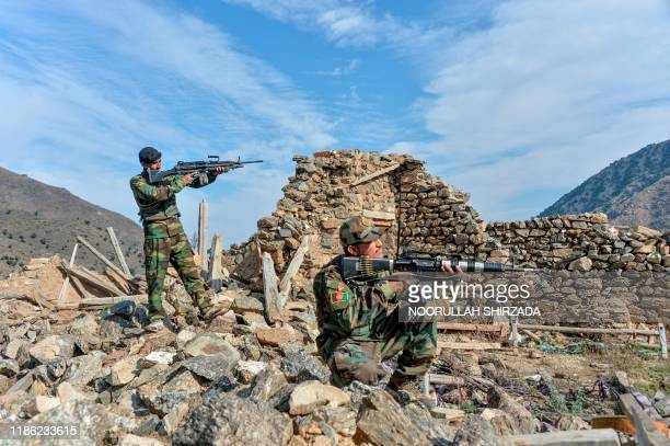 In this photograph taken on November 25 Afghan security forces take part in an ongoing operation against Islamic State militants in the Achin...