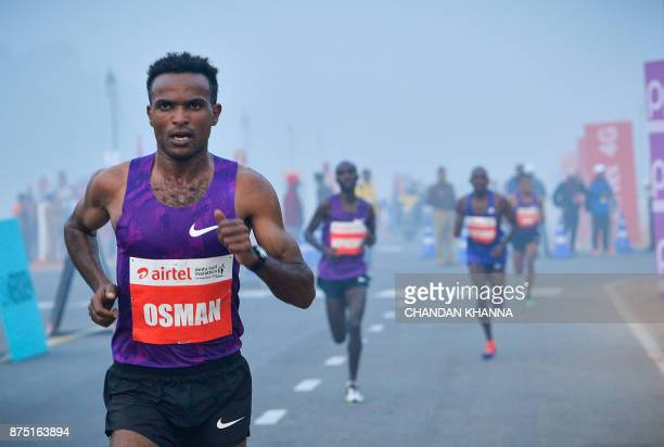 In this photograph taken on November 29 participants make their way along Rajpath during the Delhi Half Marathon in New Delhi A court in India's...