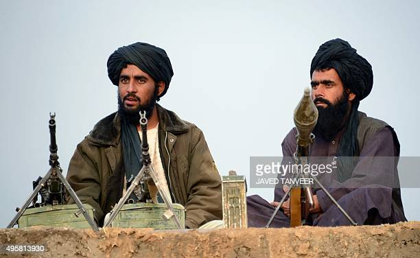 In this photograph taken on November 3 Afghan Taliban fighters listen to Mullah Mohammad Rasool Akhund the newly appointed leader of a breakaway...