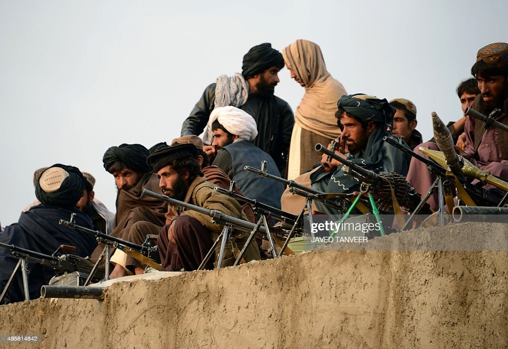 In this photograph taken on November 3, 2015, Afghan Taliban fighters listen to Mullah Mohammad Rasool Akhund (unseen), the newly appointed leader of a breakaway faction of the Taliban, at Bakwah in the western province of Farah. A breakaway faction of the Taliban has appointed its own leader in the first formal split in the Afghan militant movement under new head Mullah Mansour, posing a fresh hurdle to potential peace talks. Mullah Rasool was named the leader of the faction in a mass gathering of dissident fighters this week in the remote southwestern province of Farah, according to an AFP reporter who attended the meeting. AFP PHOTO / Javed Tanveer