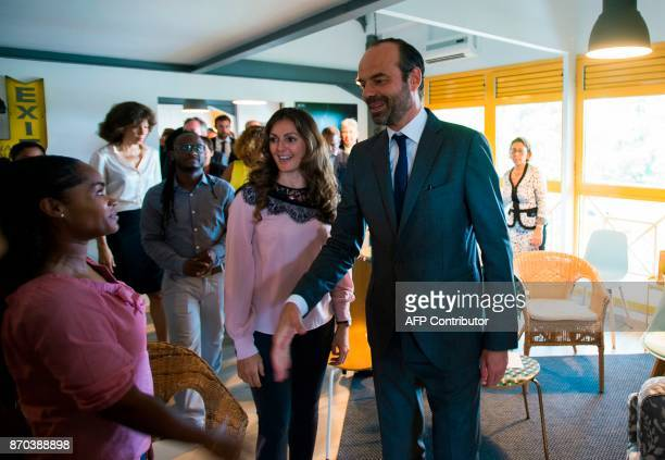 In this photograph taken on November 4 French Prime Minister Edouard Phillipe shakes hands with members of The Lumina Association at 'le cozy'...