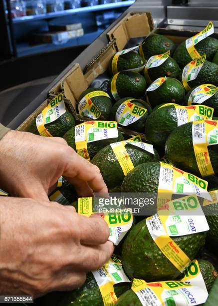 In this photograph taken on November 7 a customer looks at organic products in an Auchan 'Bio' supermarket on the outskirts of Lille in northern...