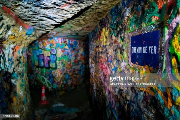 In this photograph taken on November 7 shows a street sign in a colorful part of the banned catacombs of Paris The underground quarries were used to...