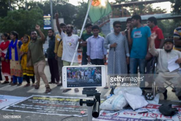 In this photograph taken on October 14 a Bangladeshi man's smartphone is set up to document a protest in Dhaka
